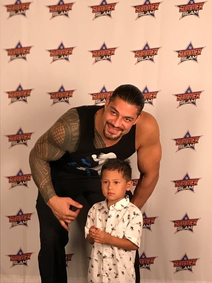 Wrestler Roman Reigns With Little Child