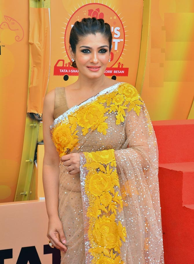 Attractive Raveena Tandon Hot & Sweet Images In Saree