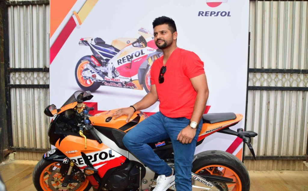 Suresh Raina Cute Wallpapers With His Bike