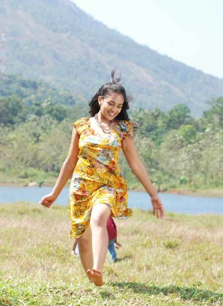 Nithya Menon Cute Images In Short Dress