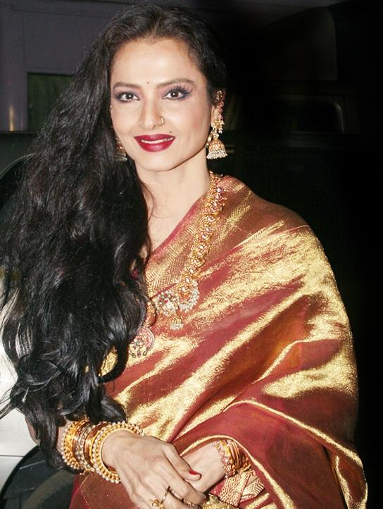 Rekha Cute Smiling Bold Pics