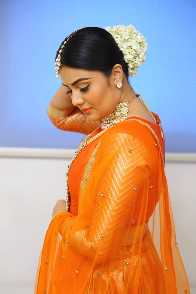 Sreemukhi New Images In Orange Saree