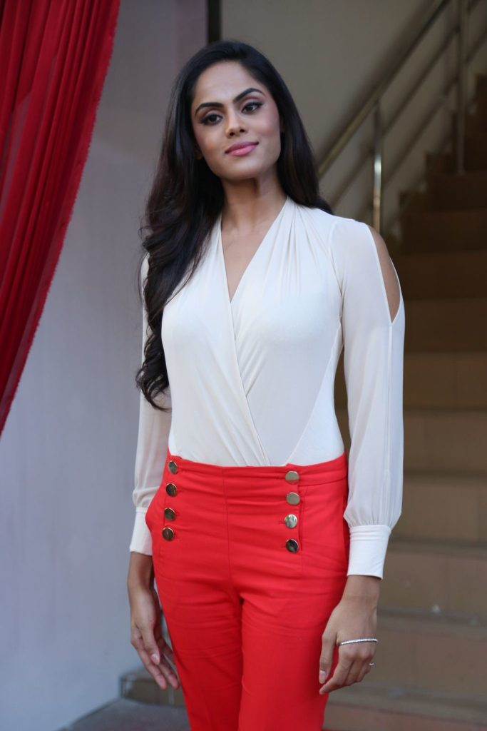 Karthika Nair In Red Jeans Top Images