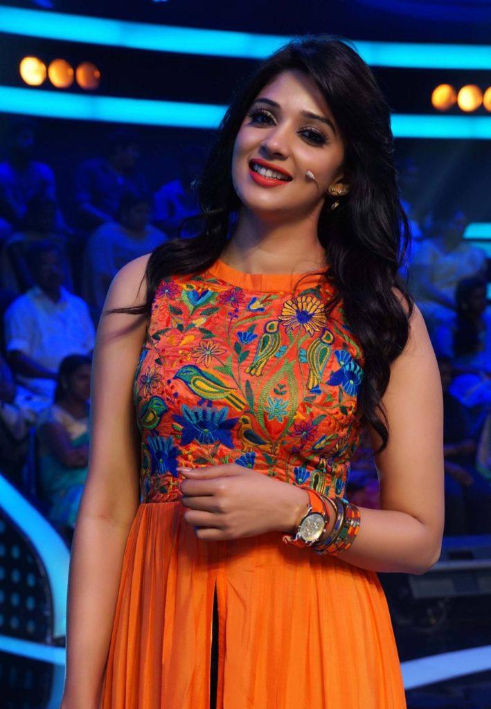 Nyla Usha In Orange Clothes Photos