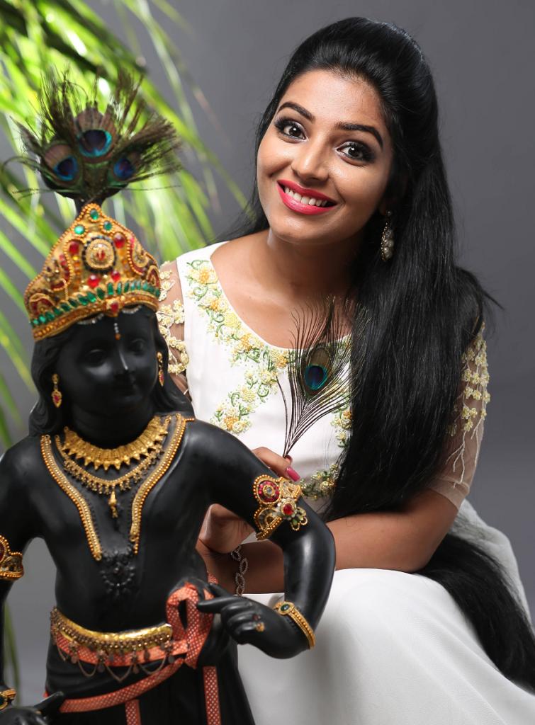 Rajisha Vijayan HD Pics With Lord Krishna Images
