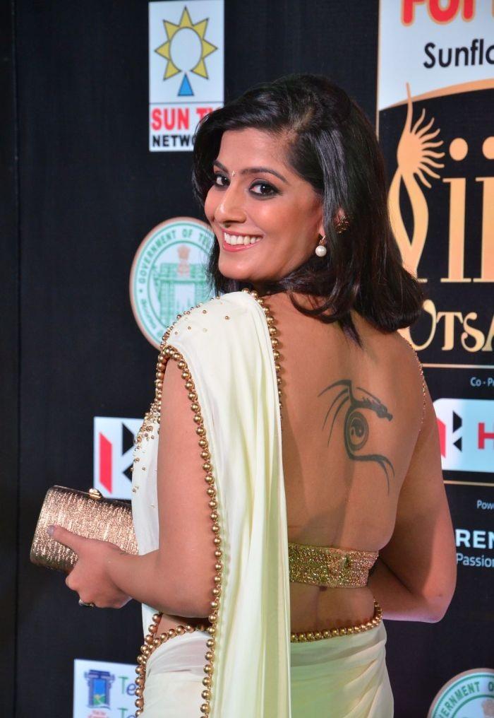 Varalakshmi In Backless Saree Photos