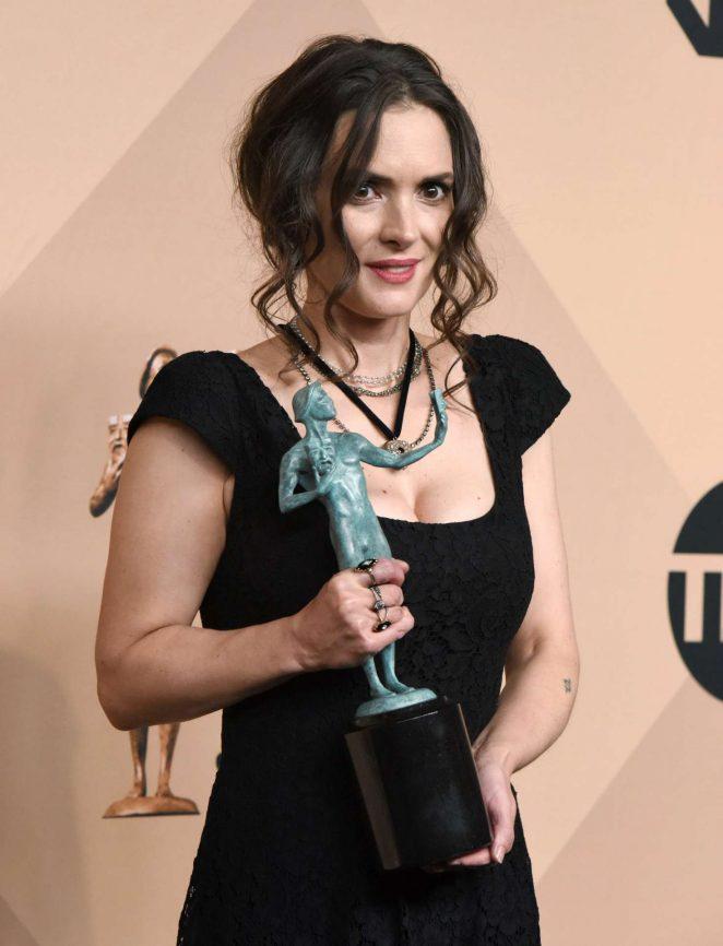 Winona Ryder With Award Photos